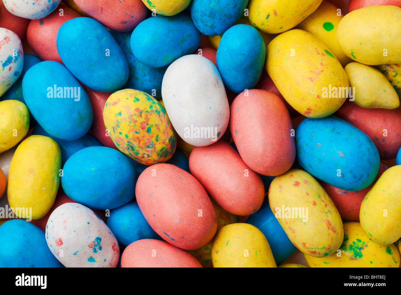 speckled eggs multi colored backdrop or background - Stock Image