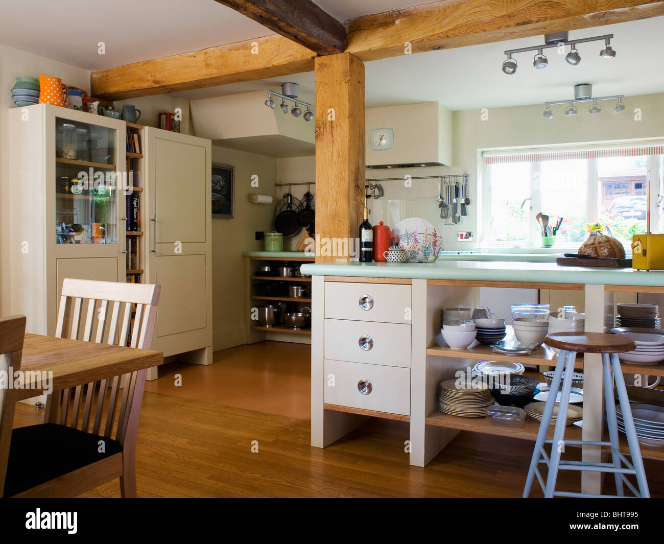 Large wooden beams in freestanding country kitchen with open storage shelves on island unit & Large wooden beams in freestanding country kitchen with open storage ...