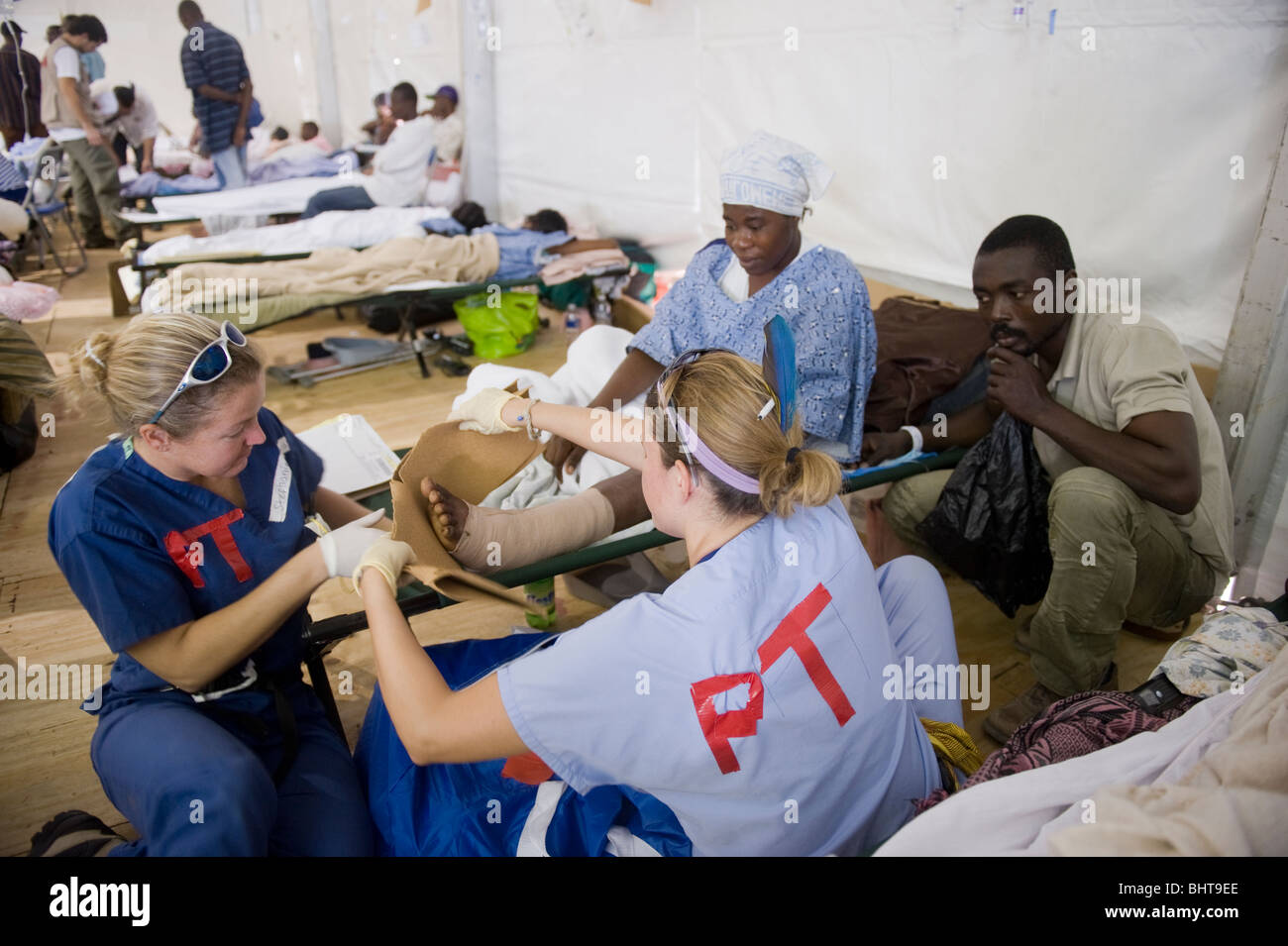 Patients receive medical care in Miami University field hospital after a 7.0 Mw earthquake struck Haiti on the 12th - Stock Image