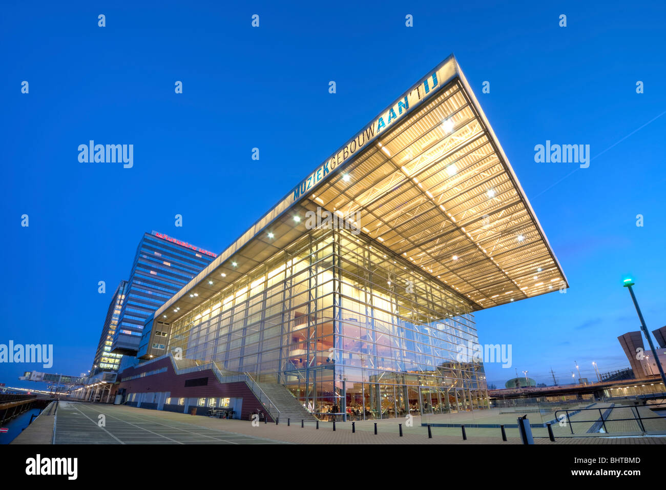 Amsterdam Muziekgebouw aan 't IJ, Music Building at the IJ; Star Ferry Restaurant at dusk. Movenpick Hotel; - Stock Image