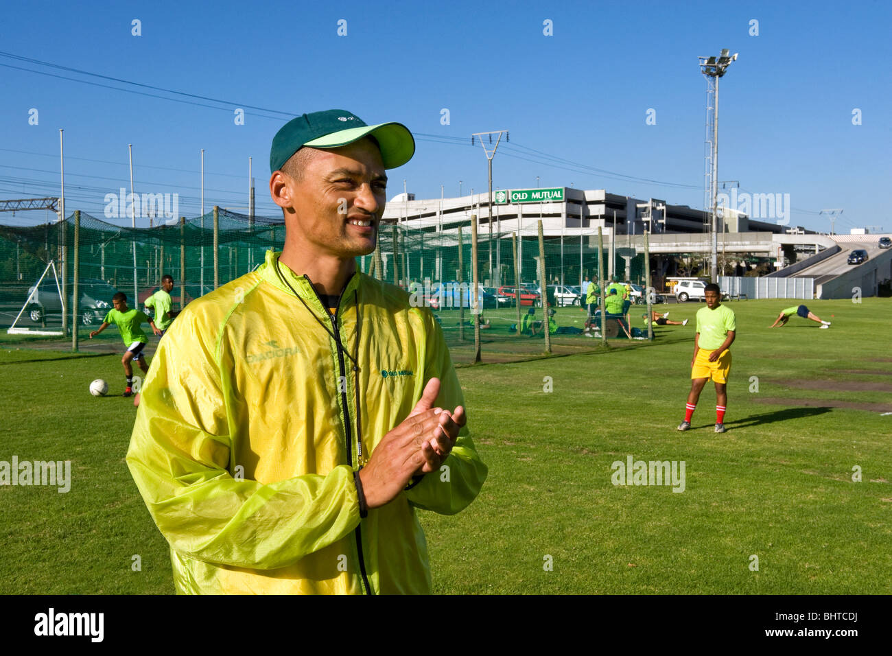 Coach giving instructions at Old Mutual Football Academy, Cape Town, South Africa - Stock Image