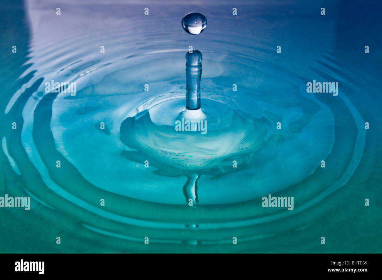 A drop of water hitting the surface - Stock Image