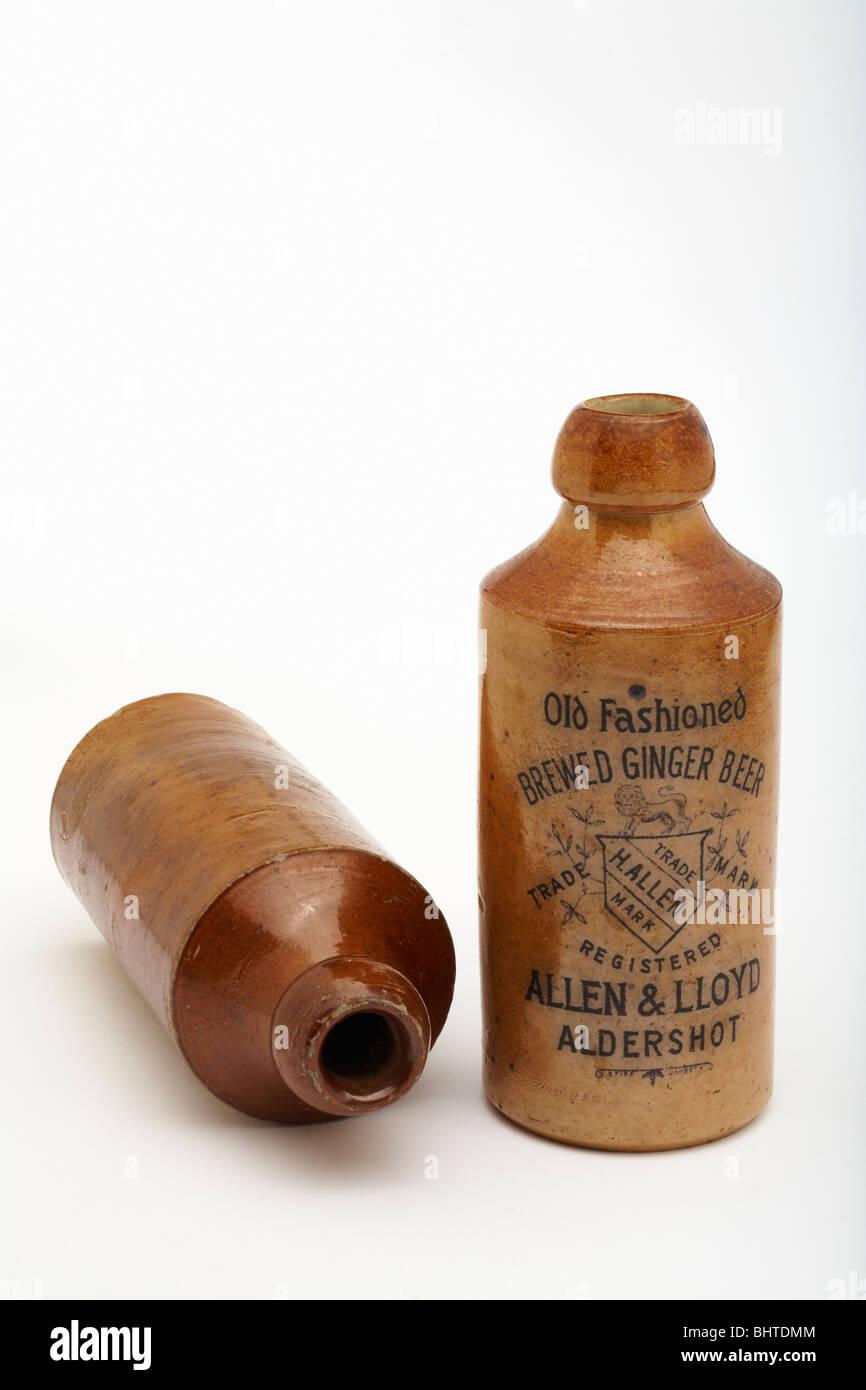 Old Antique vintage stoneware ginger beer bottles on white - Stock Image