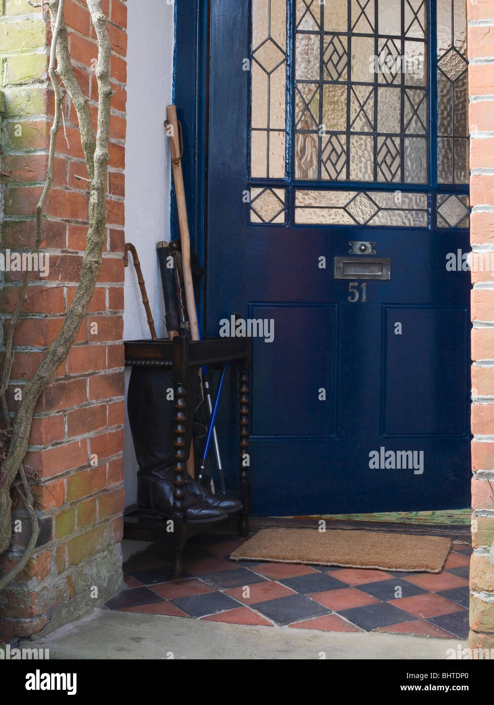 Close Up Of Black Front Door With Stained Glass Panel Stock Photo