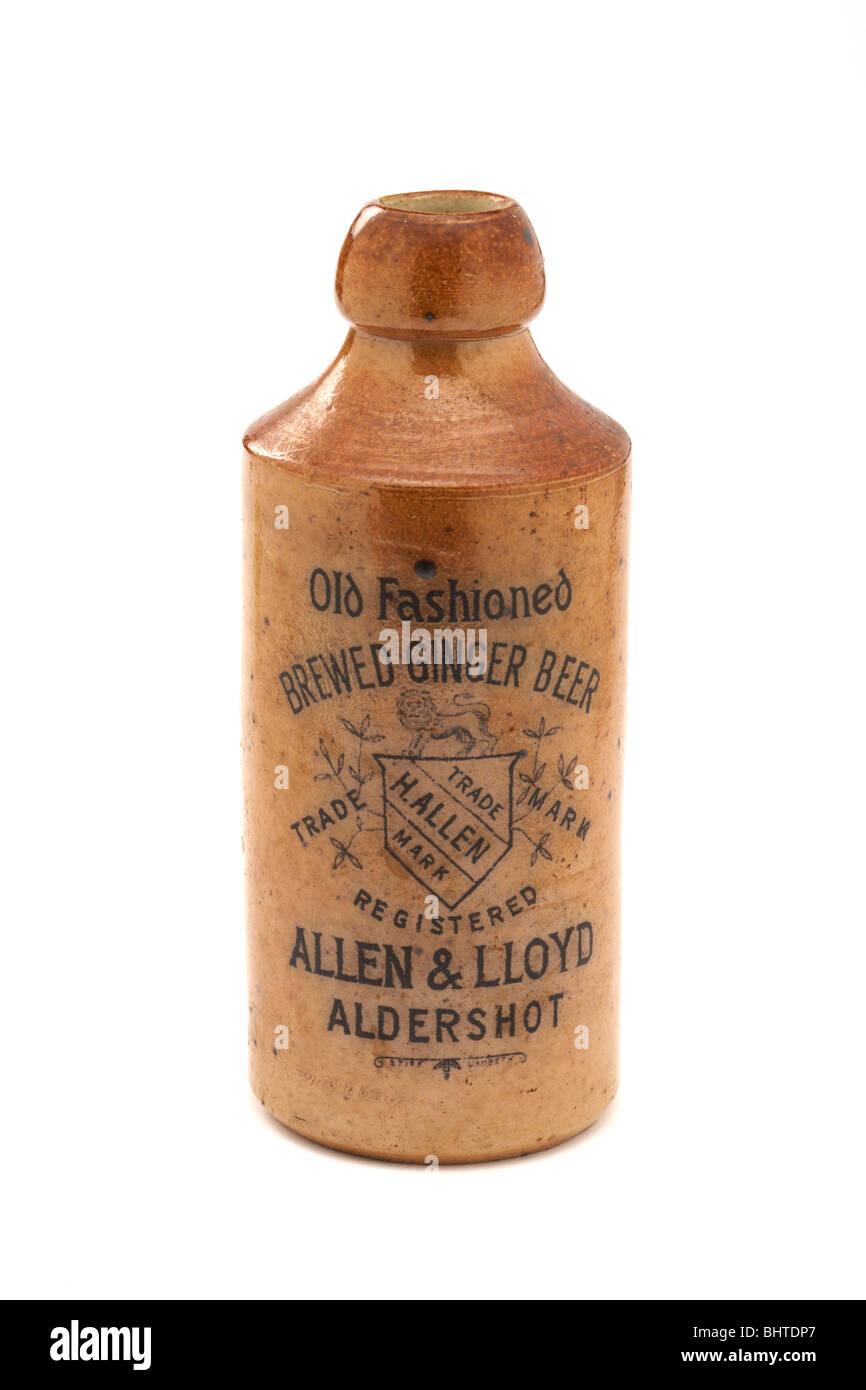 Old Antique vintage stoneware ginger beer bottle on white - Stock Image
