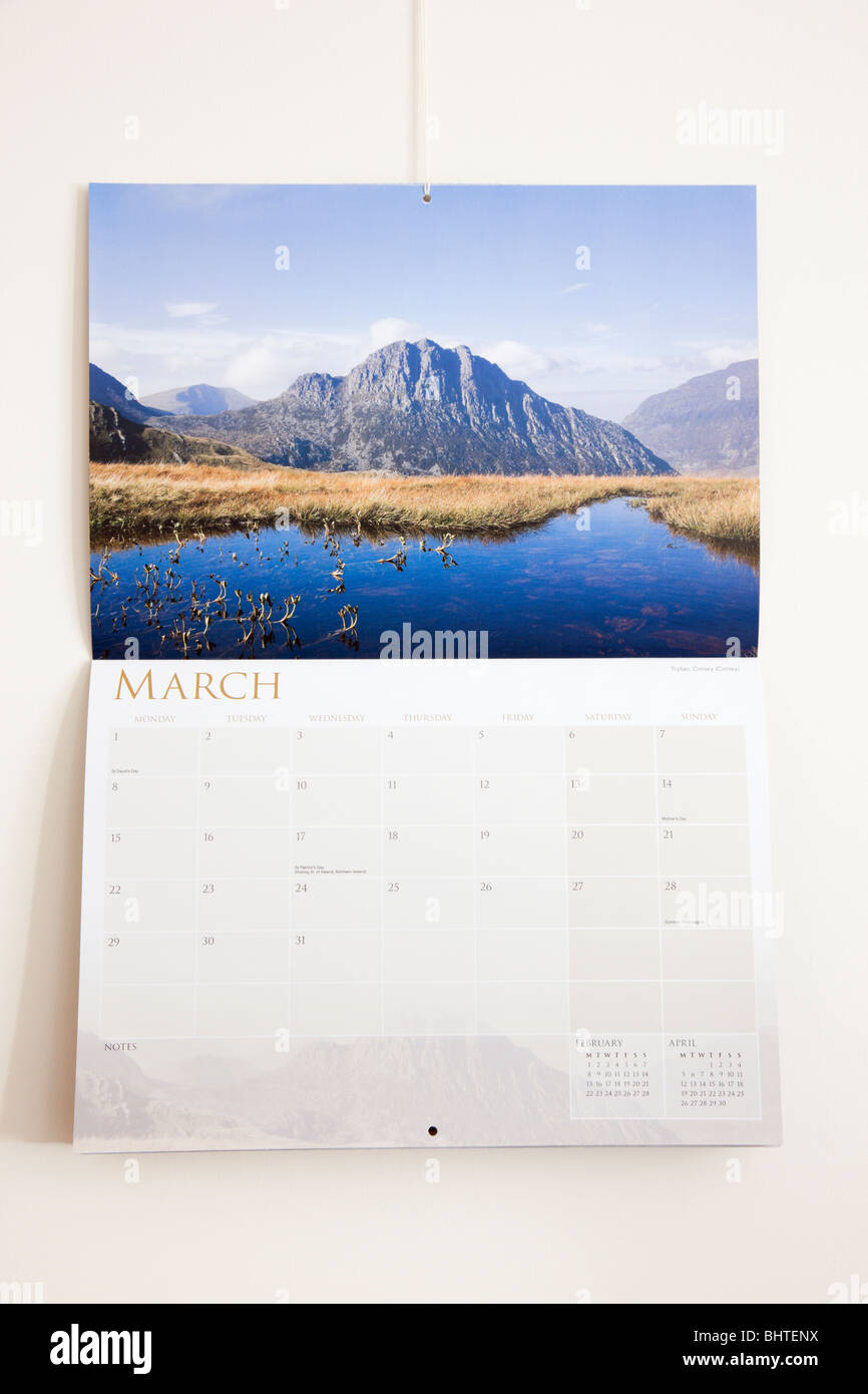 Pictorial 2010 Snowdonia calendar page showing days and dates for month of March hanging on a wall. UK, Britain. - Stock Image