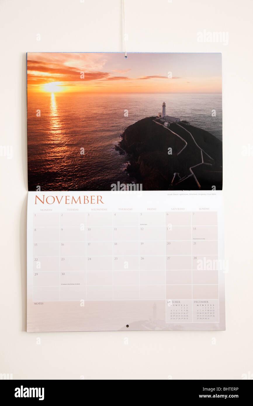 UK, Britain. Pictorial 2010 calendar page showing dates for month of November hanging on a wall - Stock Image