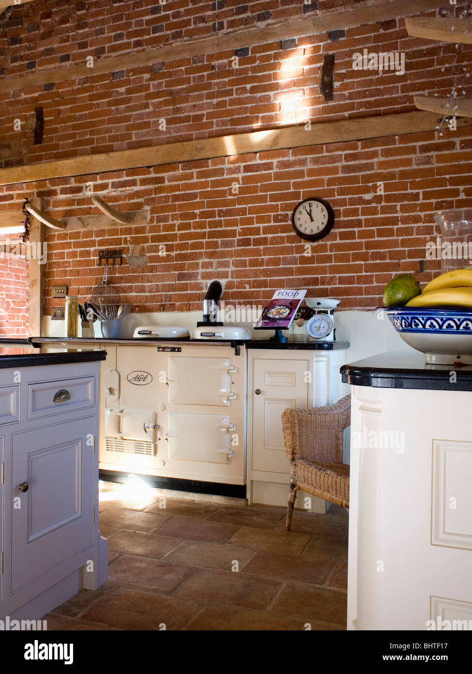 Cream Double Aga Oven In Barn Conversion Kitchen With Exposed Brick Walls