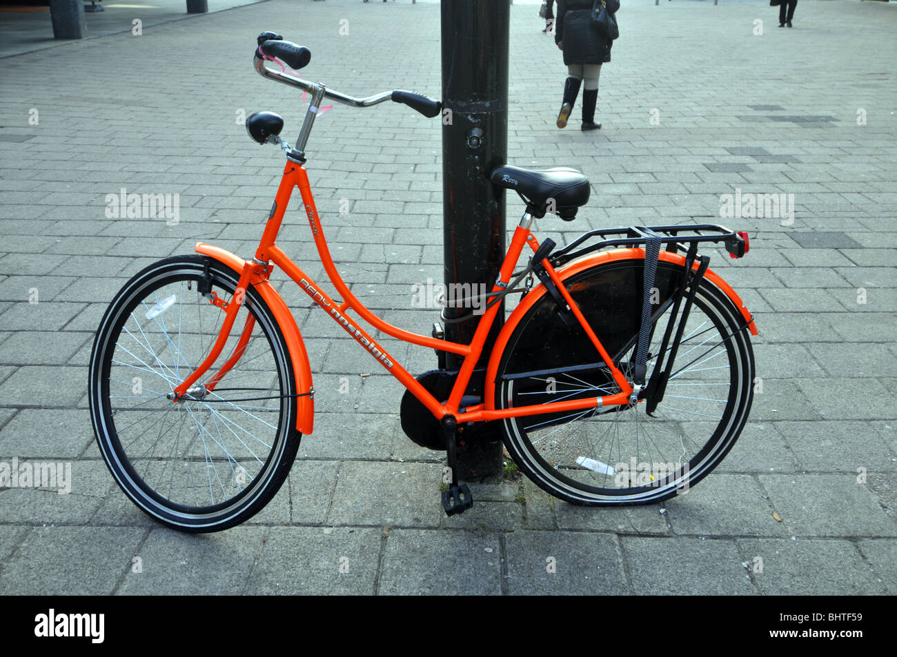Bicycle locked up in Rotterdam, Holland, Netherlands - Stock Image