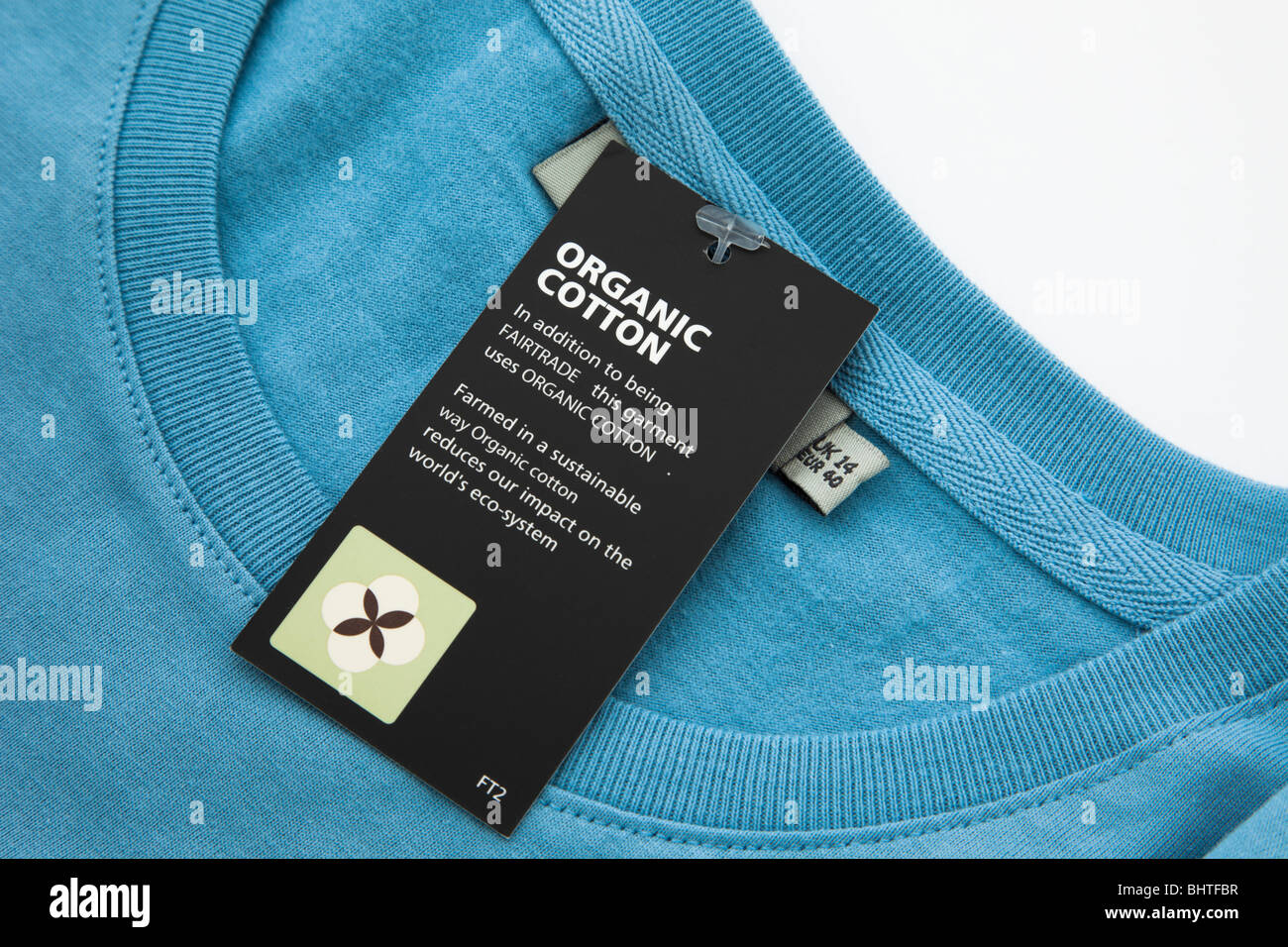 UK, Britain, Europe. Organic fairtrade cotton clothing label close-up - Stock Image