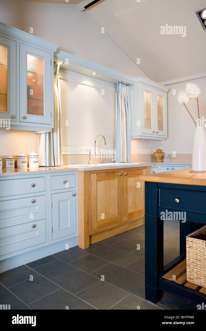 Pale Blue Fitted Units And Limestone Flooring In Modern Country