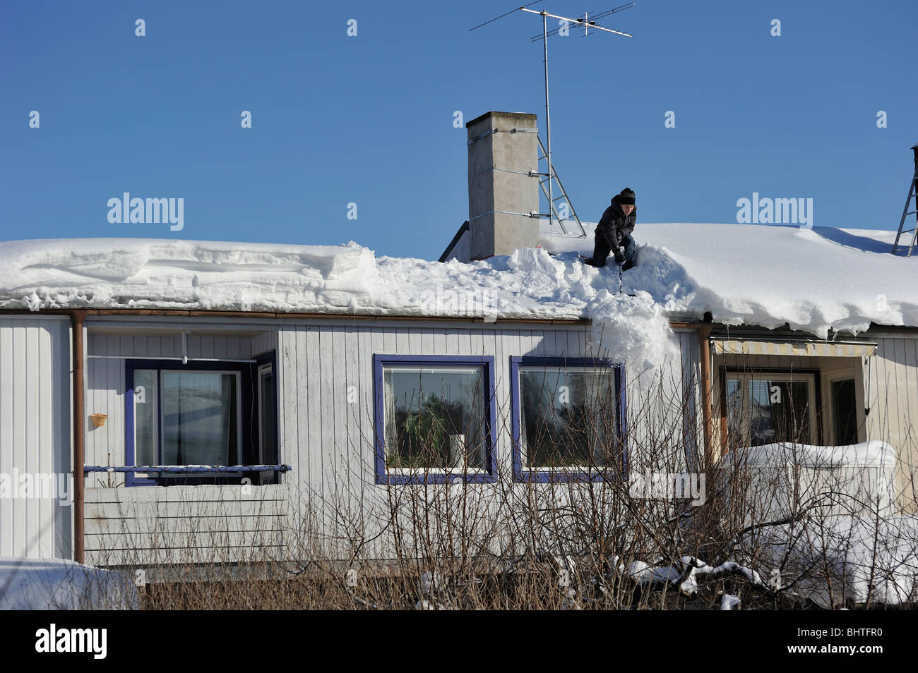 Roof snow clearer. - Stock Image