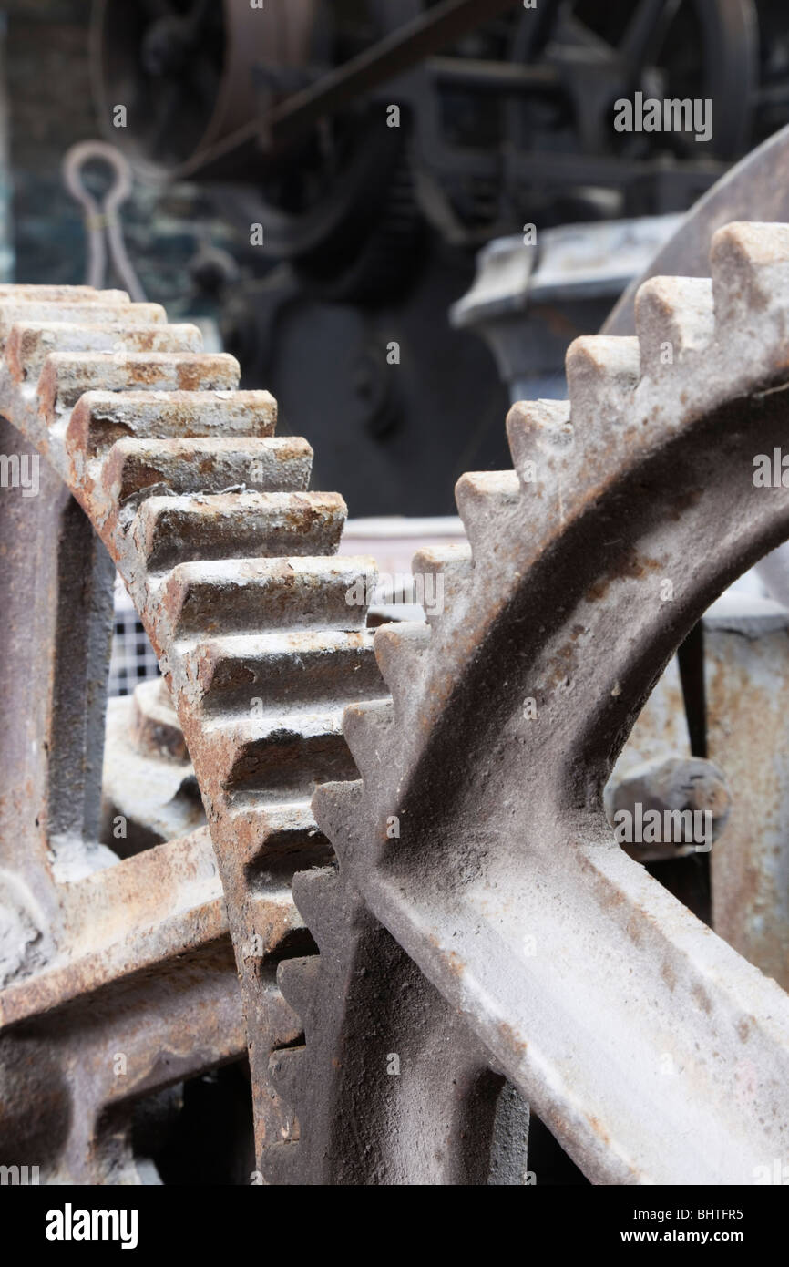 Industrial cog wheels interlocking - Stock Image
