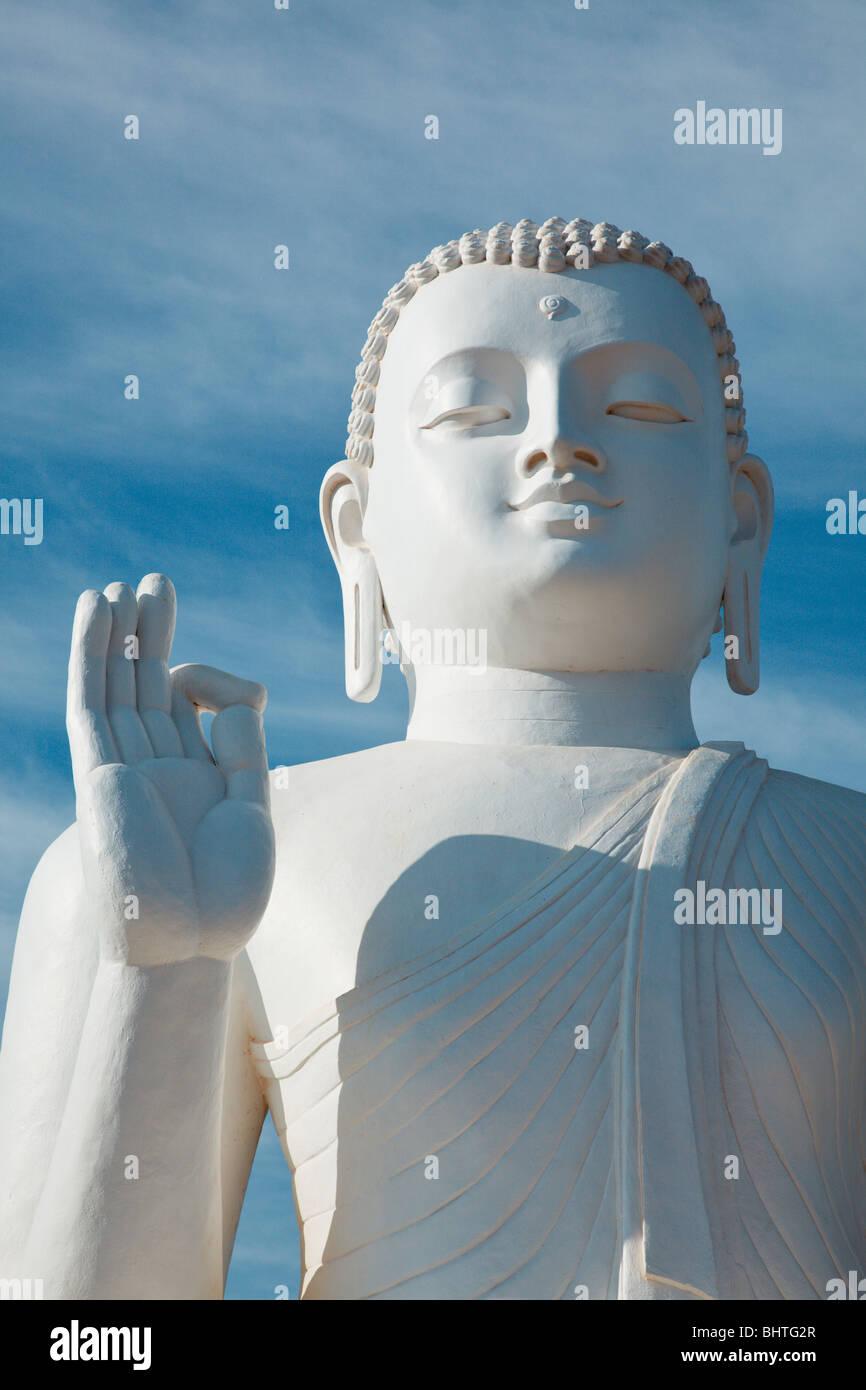 White sitting Budha image close up. Mihintale, Sri Lanka Stock Photo