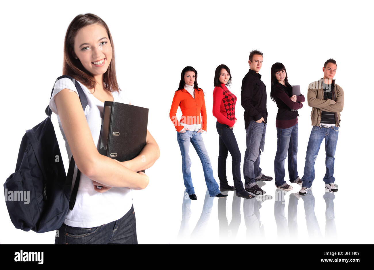 A group of ambitious students standing in front of a plain white ebackground. - Stock Image