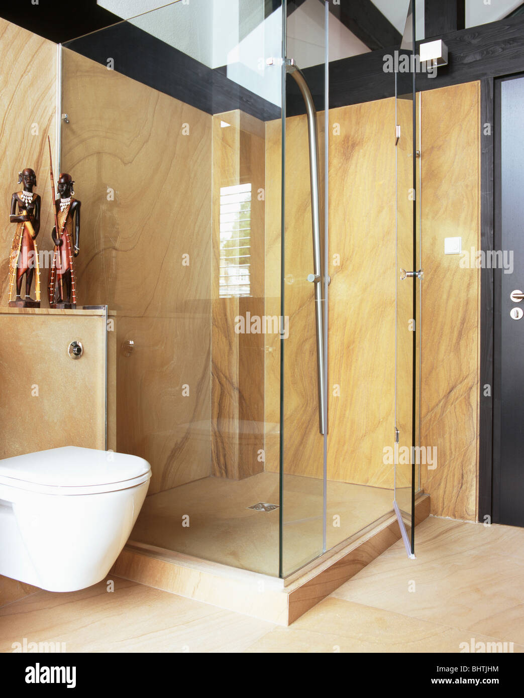 Beige Marble Walls In Glass Shower Cabinet In Modern Bathroom   Stock Image
