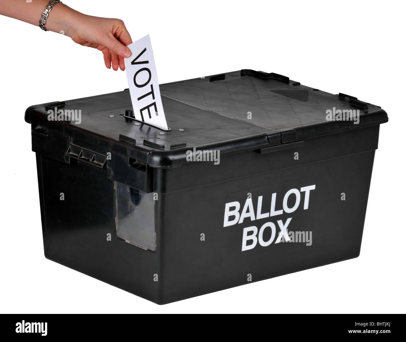 Ballot box, hand placing a vote into a ballot box, voting with ballot box - Stock Image