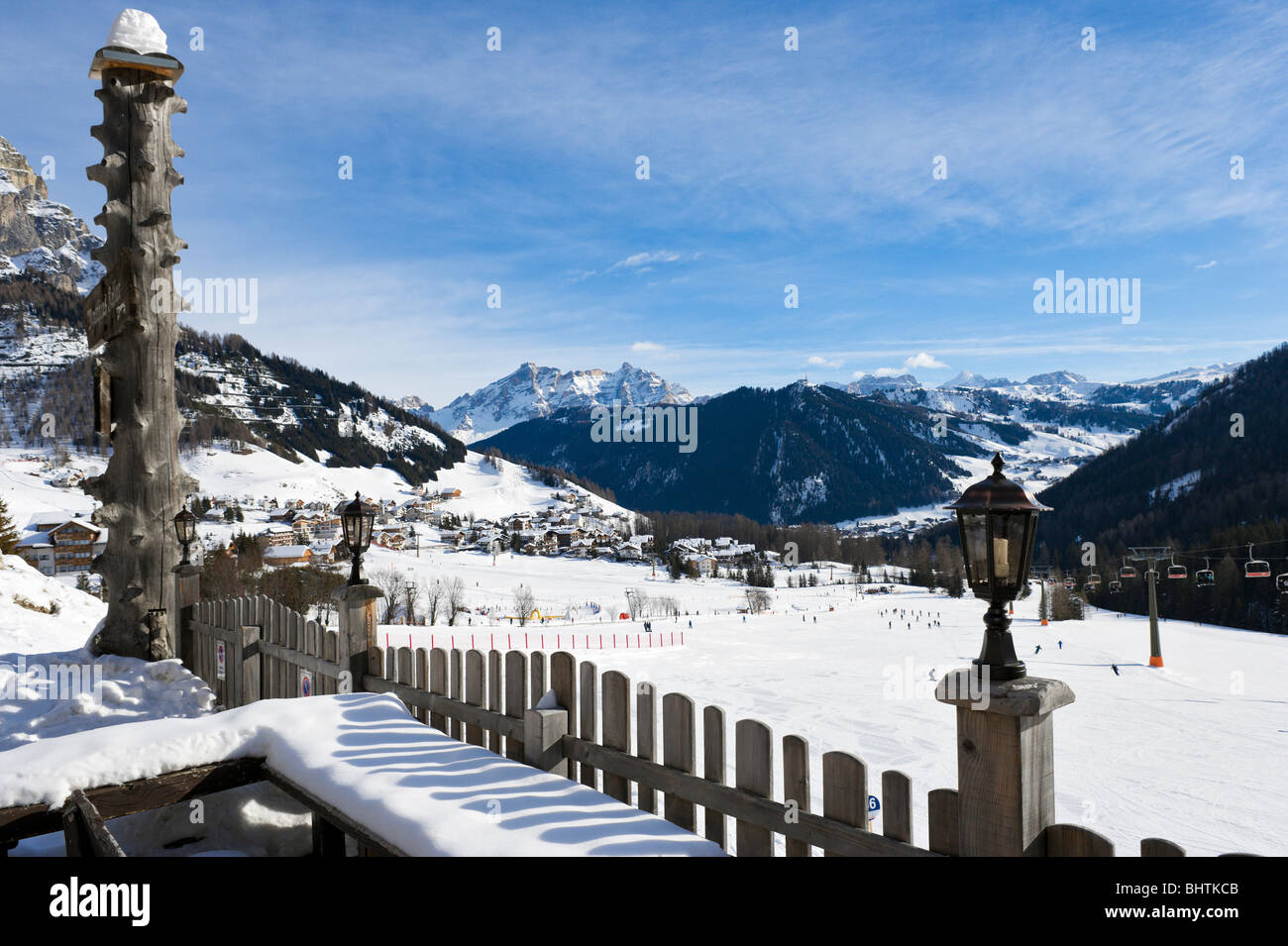 View over the resort of Colfosco with Corvara in the distance, Sella Ronda Ski Area, Alta Badia, Dolomites, Italy Stock Photo