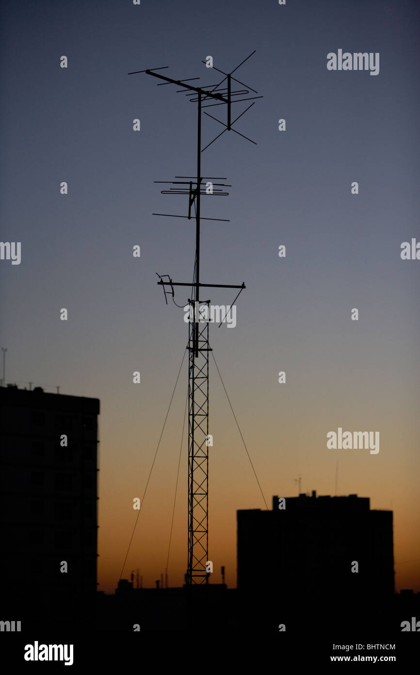 television and radio broadcast receiving antennae on rooftops in the evening buenos aires argentina - Stock Image