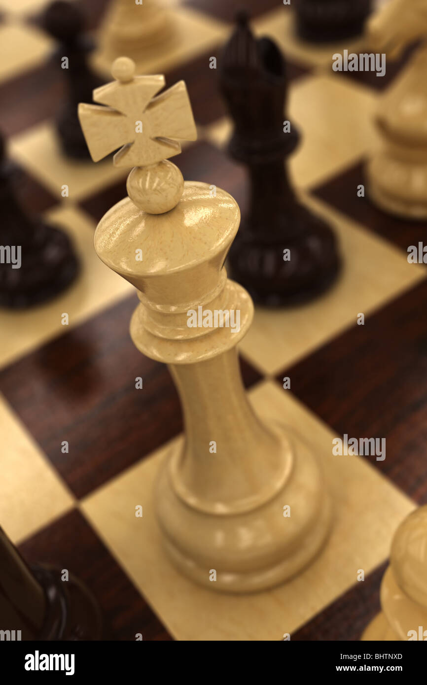 White chess king on chess board - Stock Image