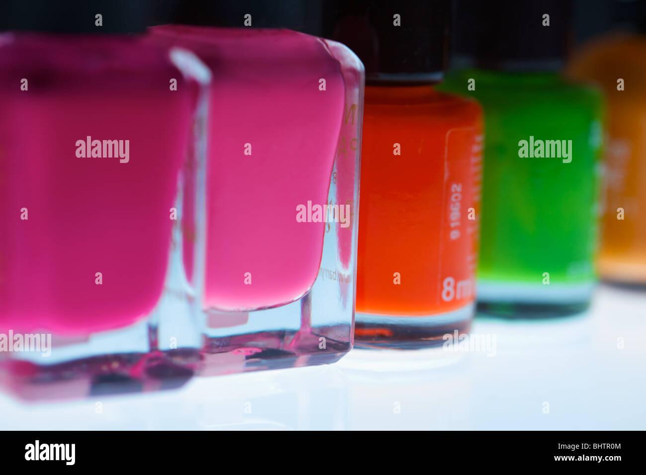 nail varnish bottles close up using a macro lens - Stock Image