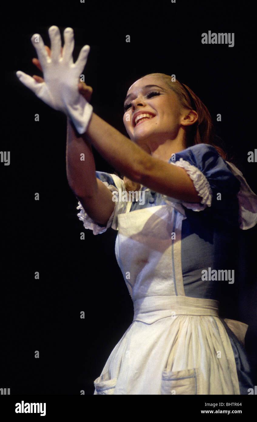 Marta Barahona as Alice in Derek Deane's production of Alice In Wonderland for English National Ballet. - Stock Image