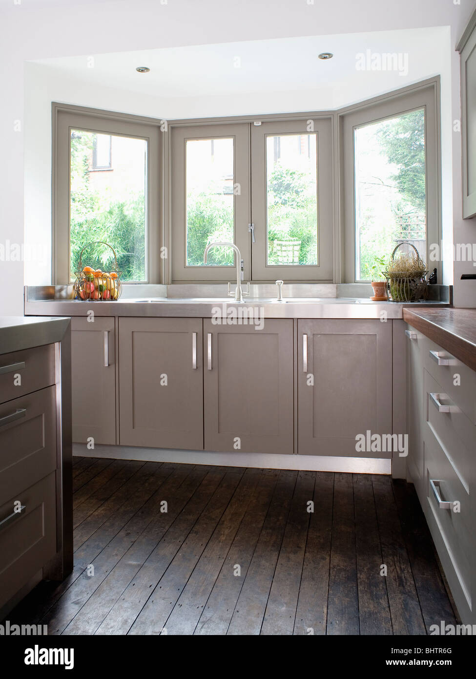 Dark Gray Wooden Flooring In Modern Kitchen With Gray Painted