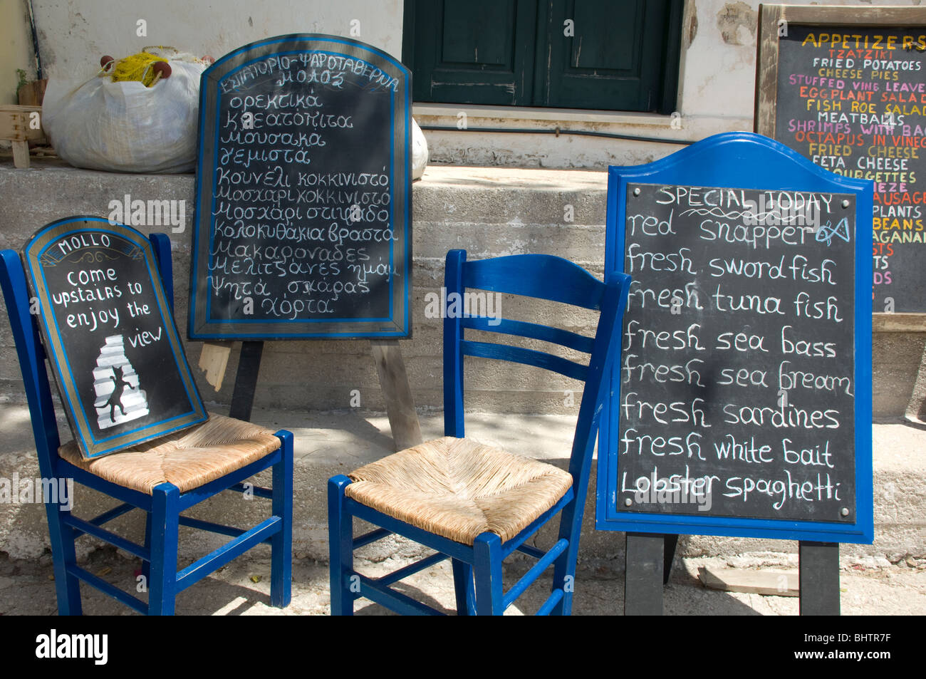 Chalk board menus in Greek and English at a taverna in Asos, Kefalonia, the Ionian Islands, Greece - Stock Image
