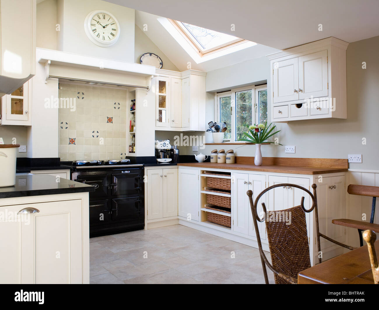 Limestone Flooring In Traditional Cream Kitchen Extension With Black Aga Oven Stock Photo Alamy