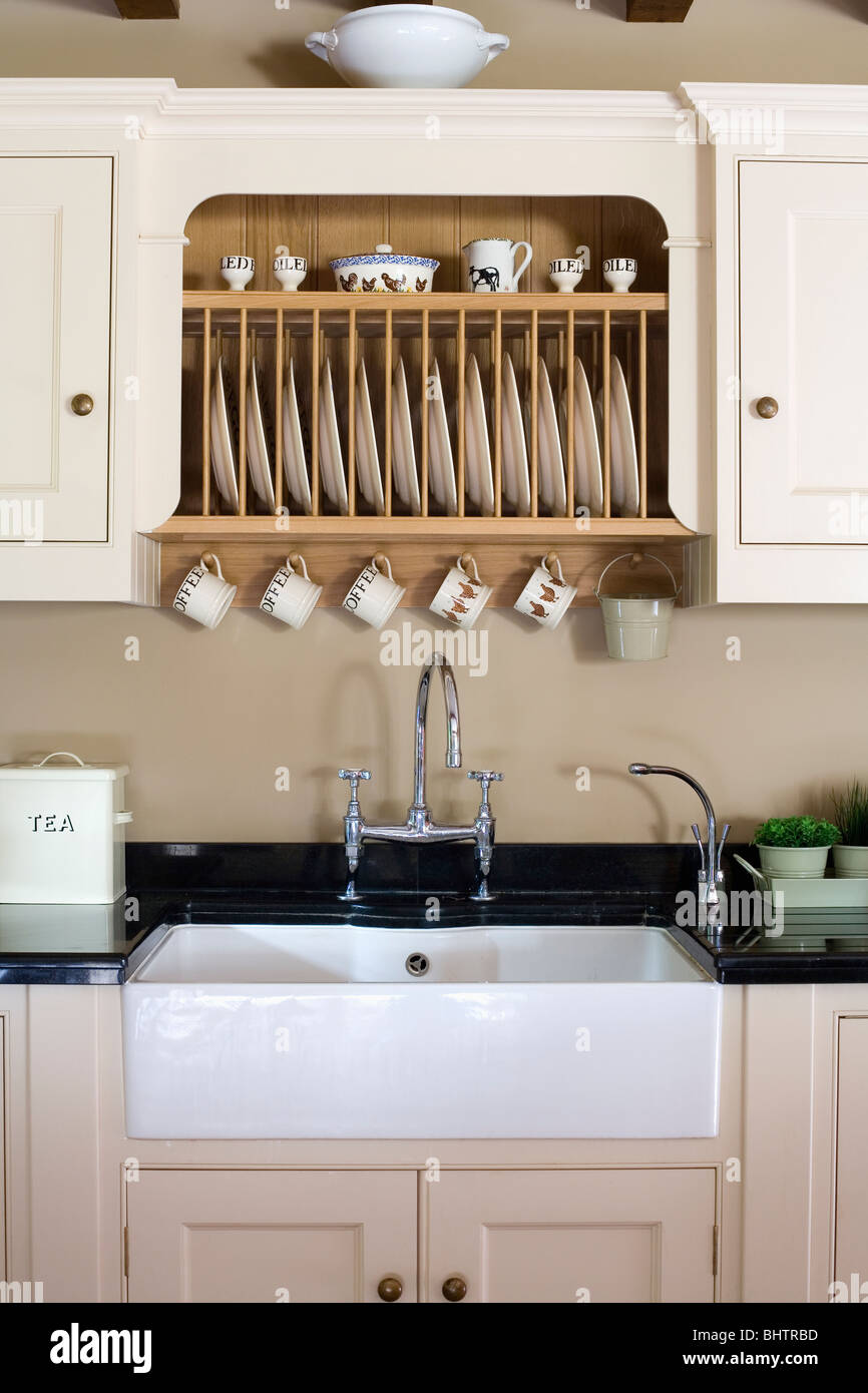 Fitted Plate Rack In Fitted Cream Cupboard Above White Butler S Sink Stock Photo Alamy