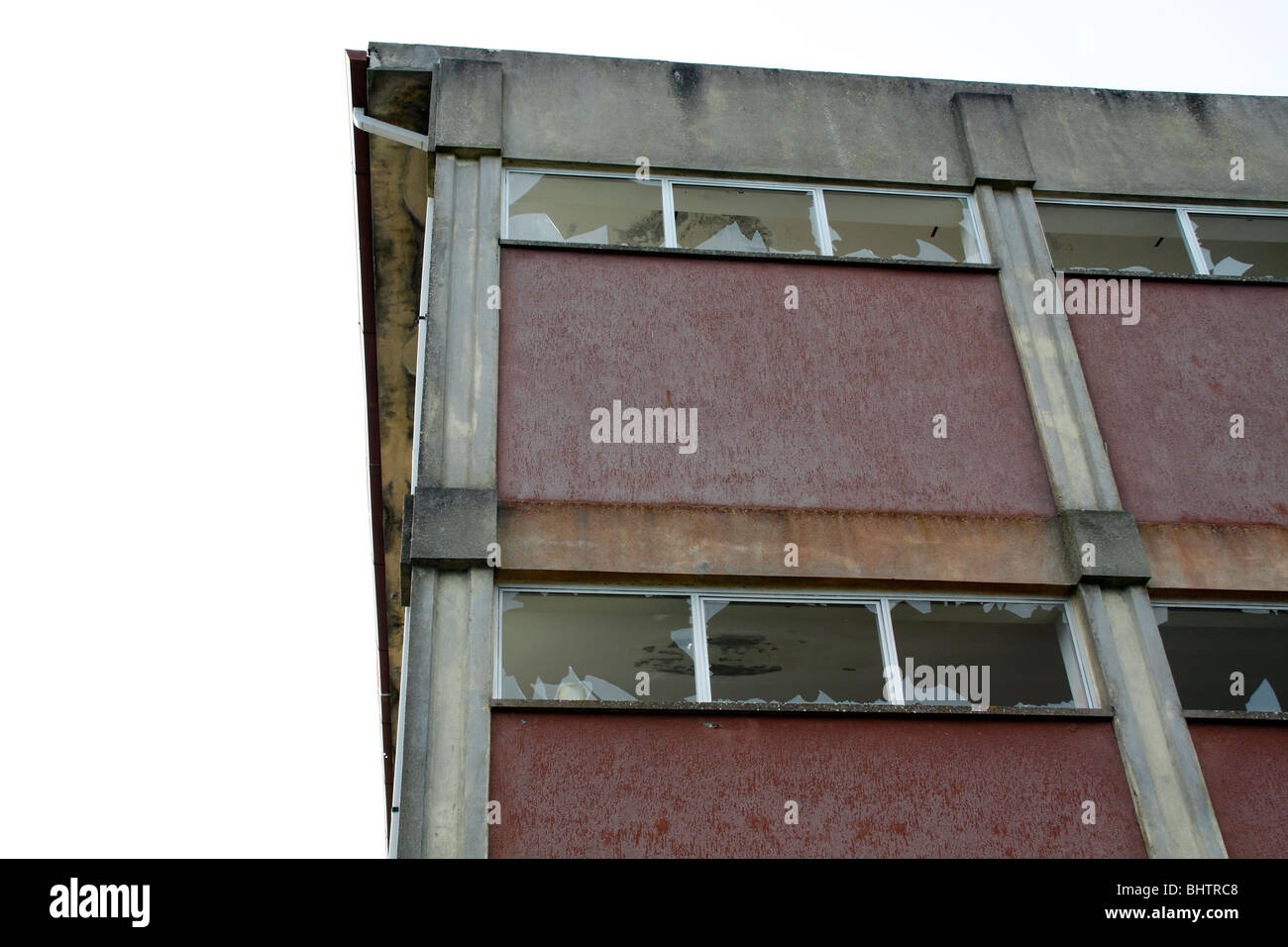 Abandoned building with broken windows - Stock Image