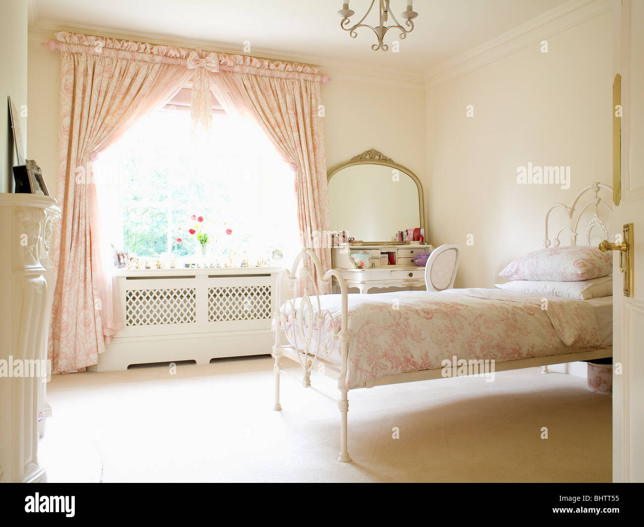 Pink Toile-de-Jouy Curtains On Window In Cream Country Bedroom With Stock Photo: 28205329