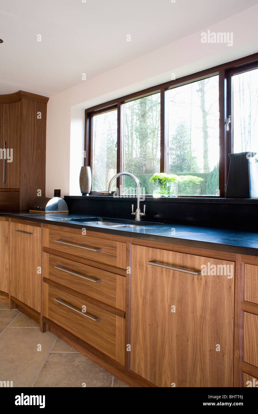 Window Above Sink In Walnut Fitted Unit With Black Granite