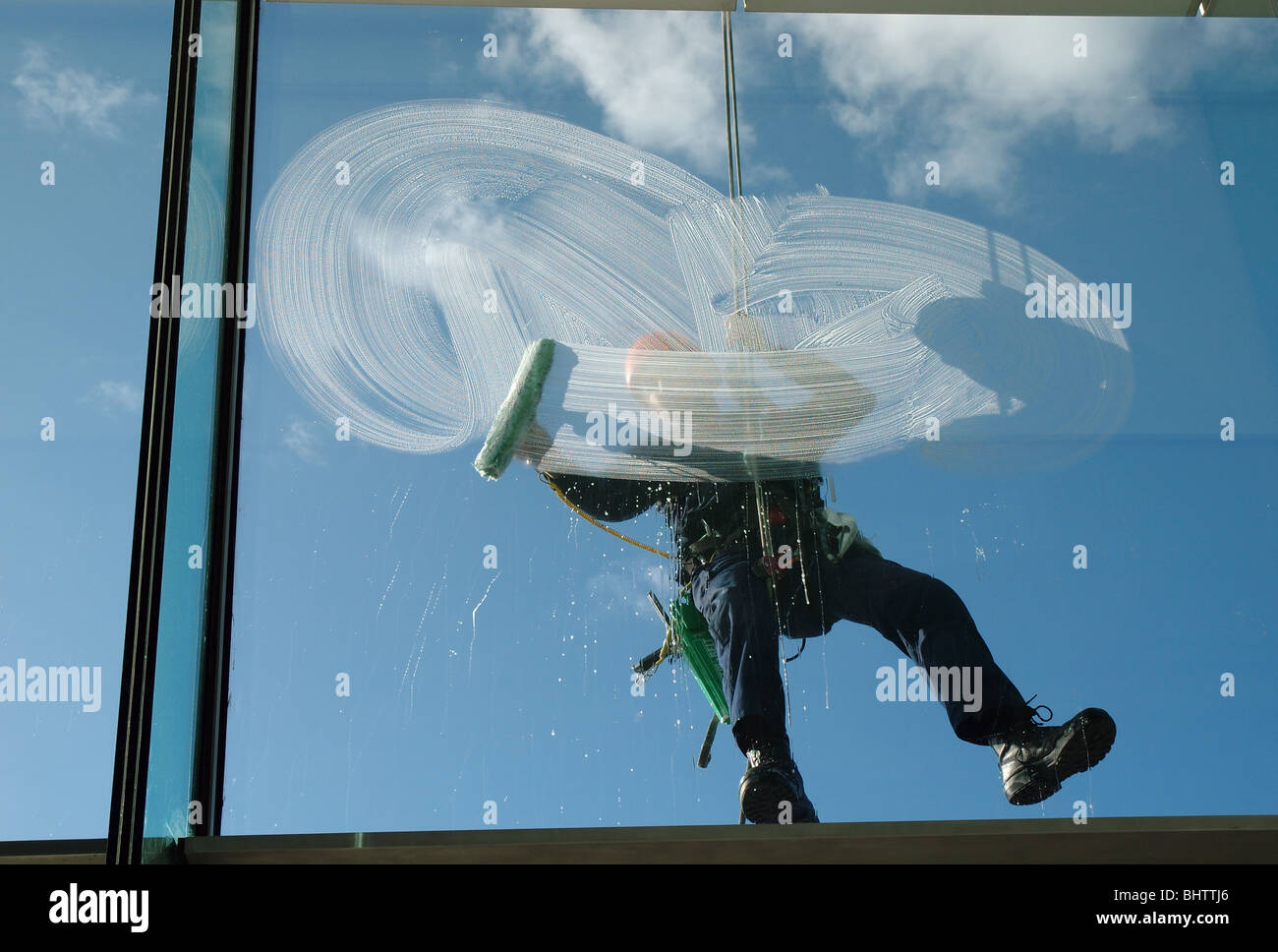 window cleaner on the outside of the Baltic Centre, Gateshead, Tyne and Wear, England, UK - Stock Image