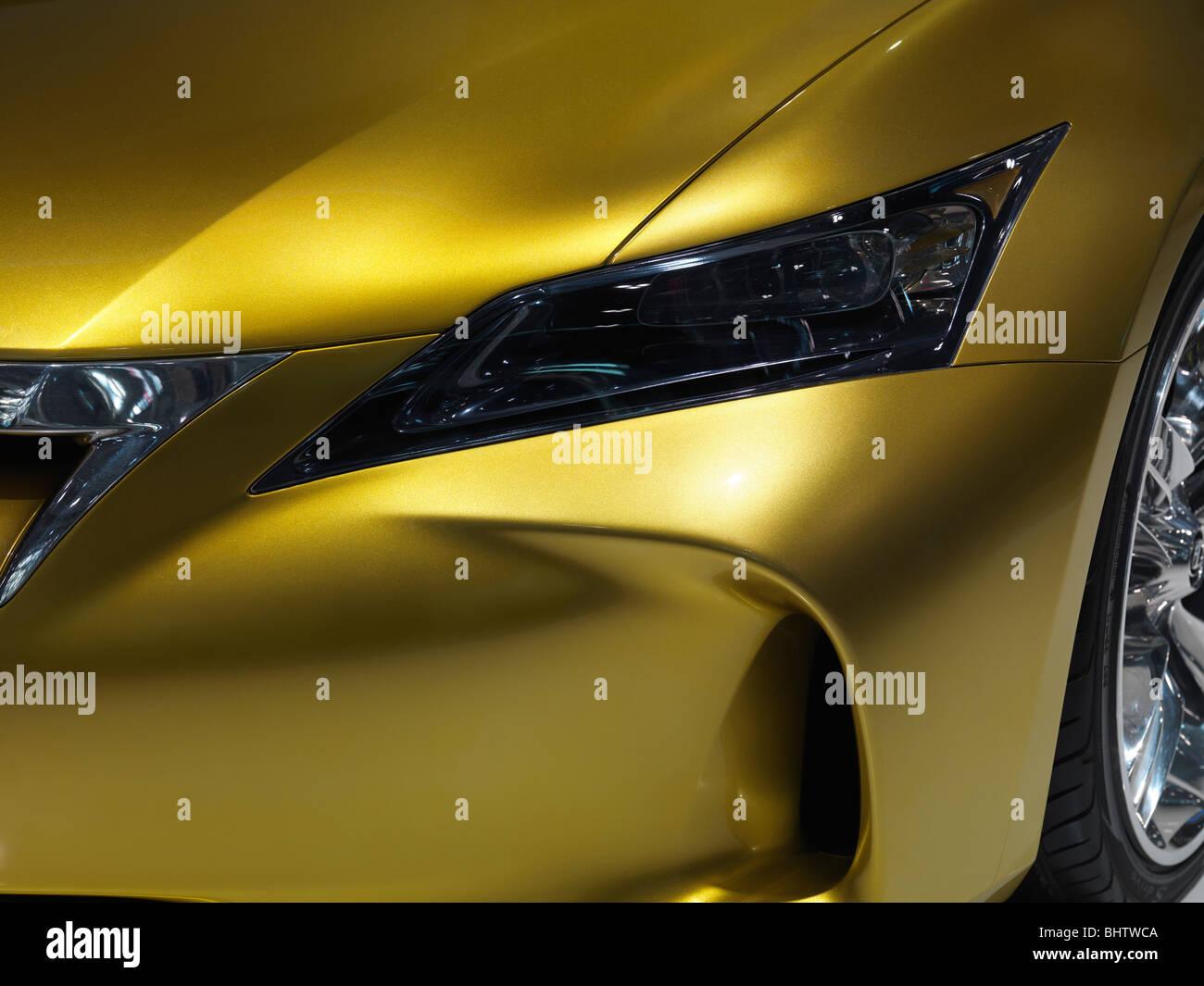 Closeup of exotic gold shiny car Lexus LF-Ch hybrid concept car - Stock Image