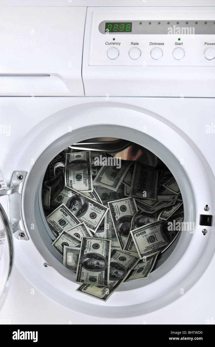 Money laundering concept - 100 dollar bills laundered in a washing machine. - Stock Image