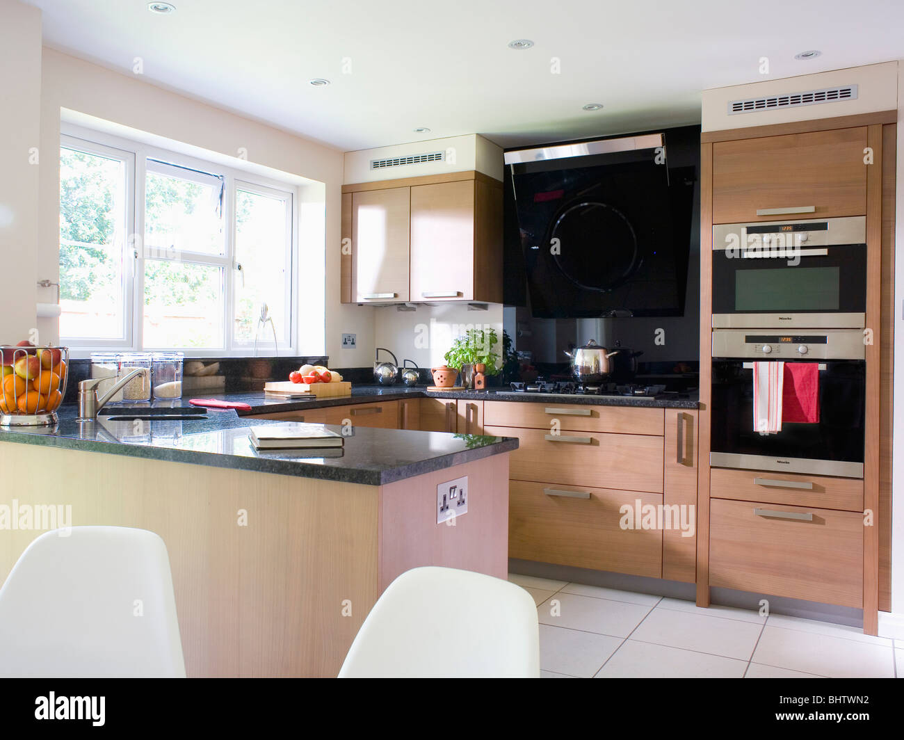 eye level double oven in pale wood fitted unit in modern. Black Bedroom Furniture Sets. Home Design Ideas