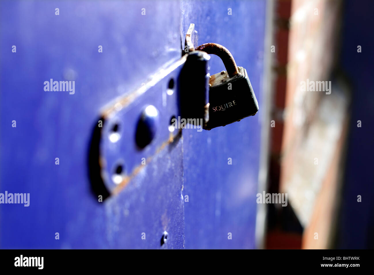 Padlocked blue doors - Stock Image