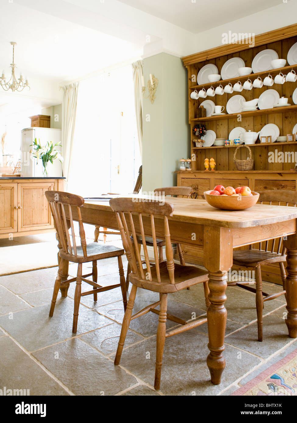 Old Pine Table And Chairs In Country Kitchen With Pine Dresser And  Flagstone Floor