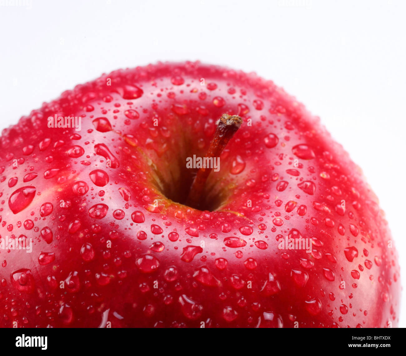 Red apple with leaf on a white background - Stock Image