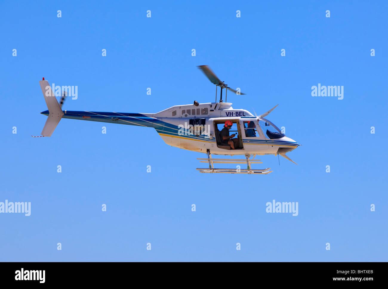 Bell 206B JetRanger helicopter in flight - Stock Image