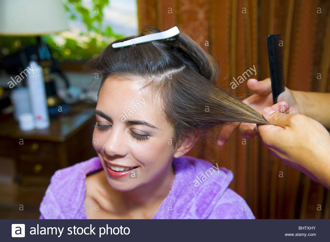 Woman at a salon during hair styling - Stock Image