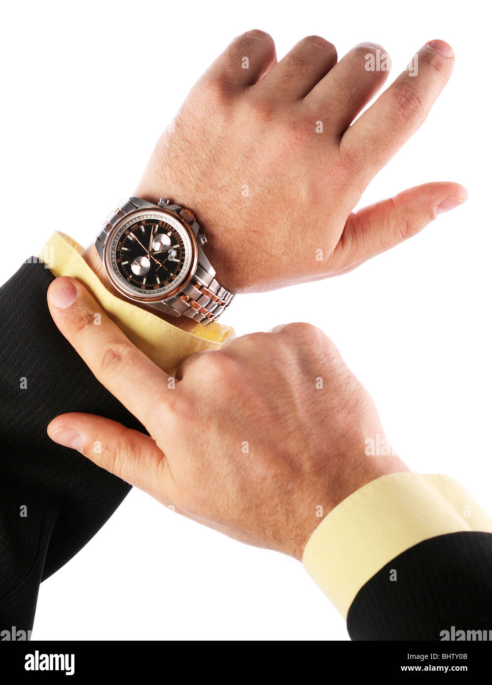 Businessman looks at his watch - Stock Image