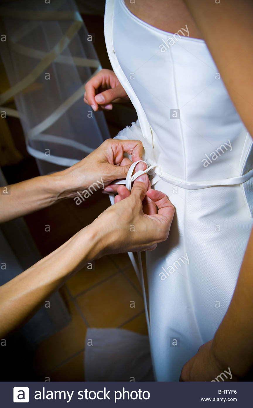 Lacing up the front wedding dress - Stock Image