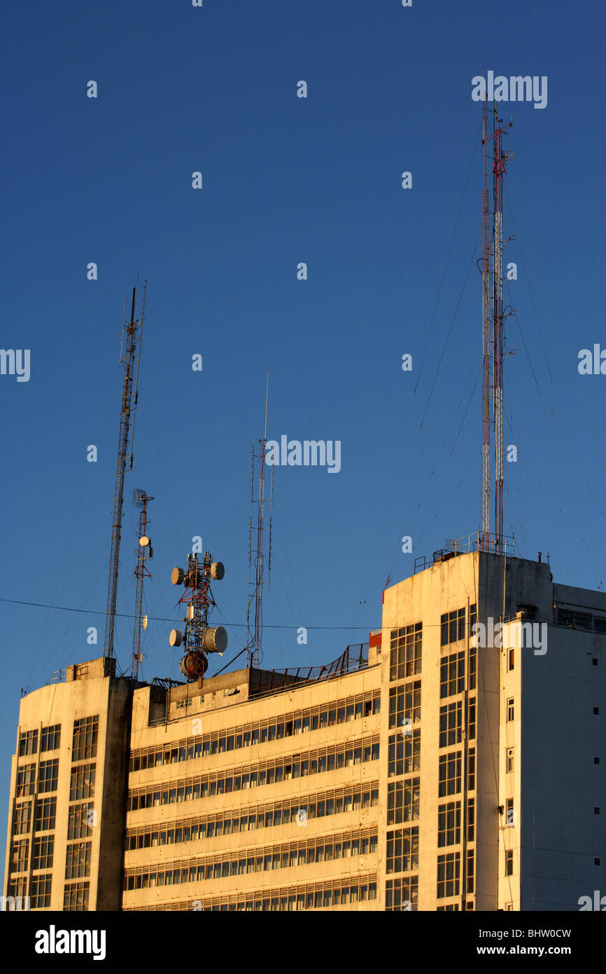 transmission aerials and microwave antennae on rooftop of an apartment building in the evening buenos aires argentina - Stock Image