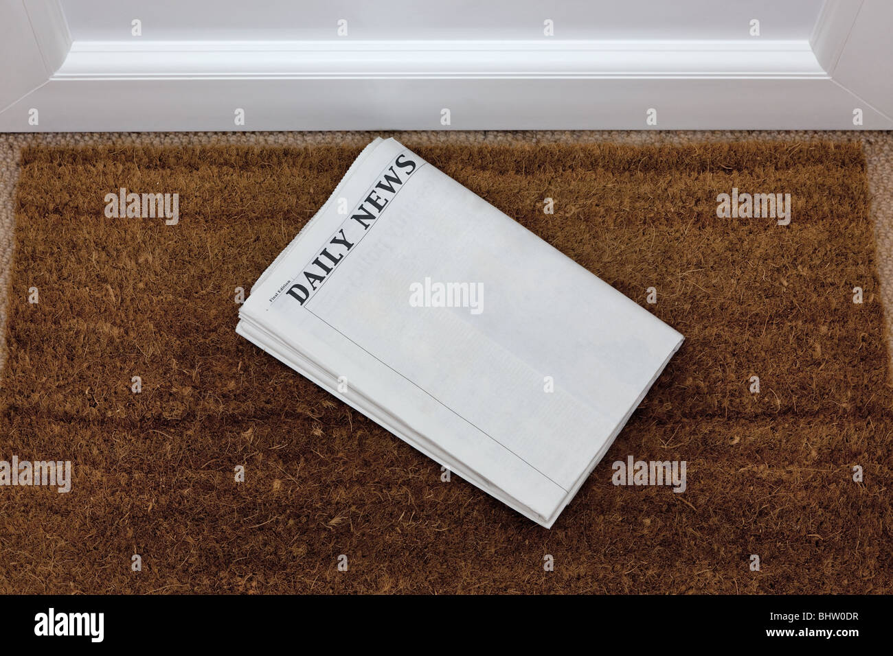 Newspaper lying on a doormat, blank to add your own text. Generic titles added by me. - Stock Image