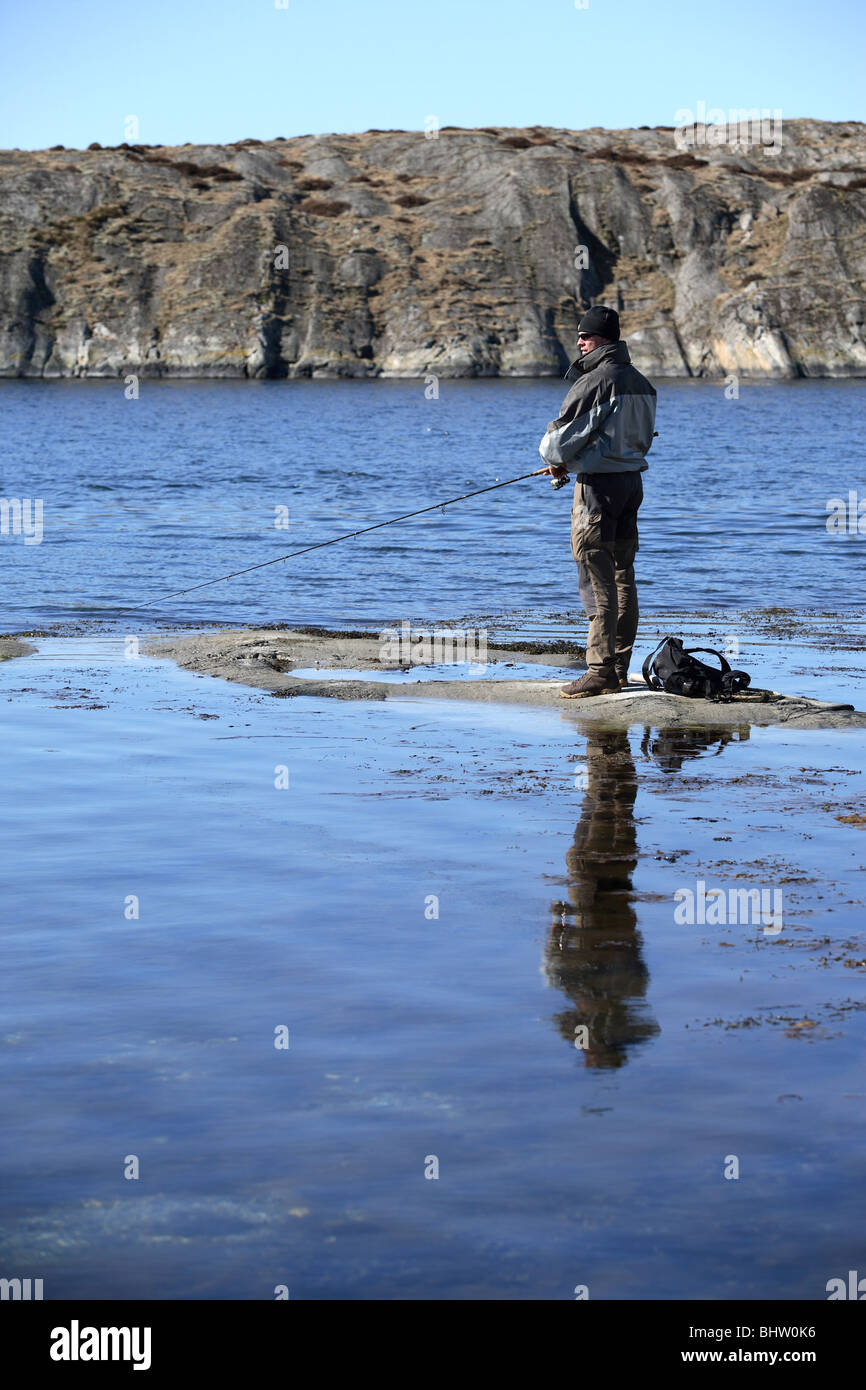Man fishing on the coast of the Baltic Sea, Stocken, Orust, Sweden - Stock Image
