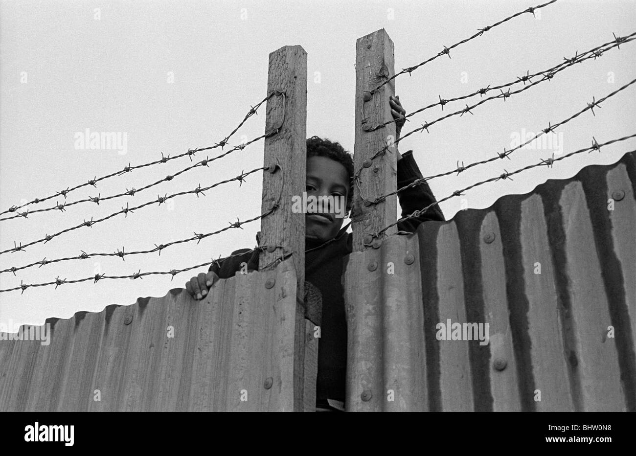 Boy in a wire, May 1980 at Brixton, South London UK. - Stock Image