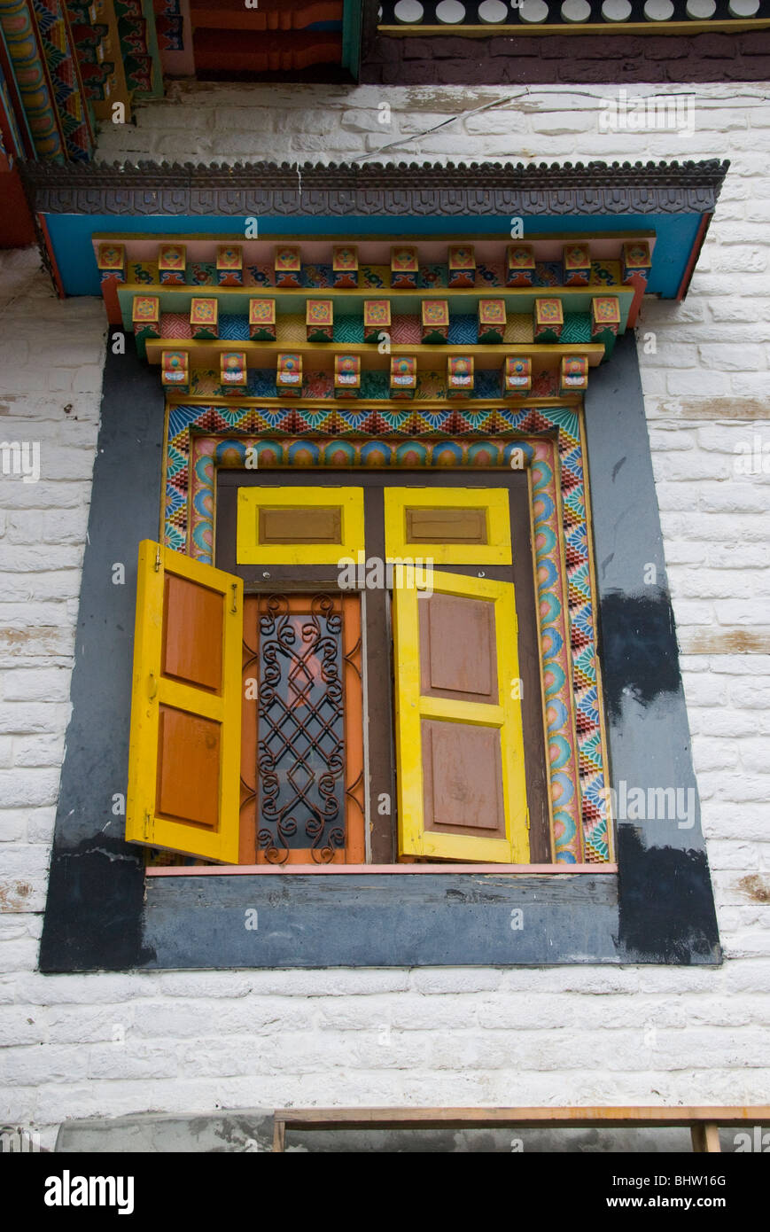Decorated window in Ghompa at Monastery in Upper Pisang, Annapurna Circuit, Nepal - Stock Image