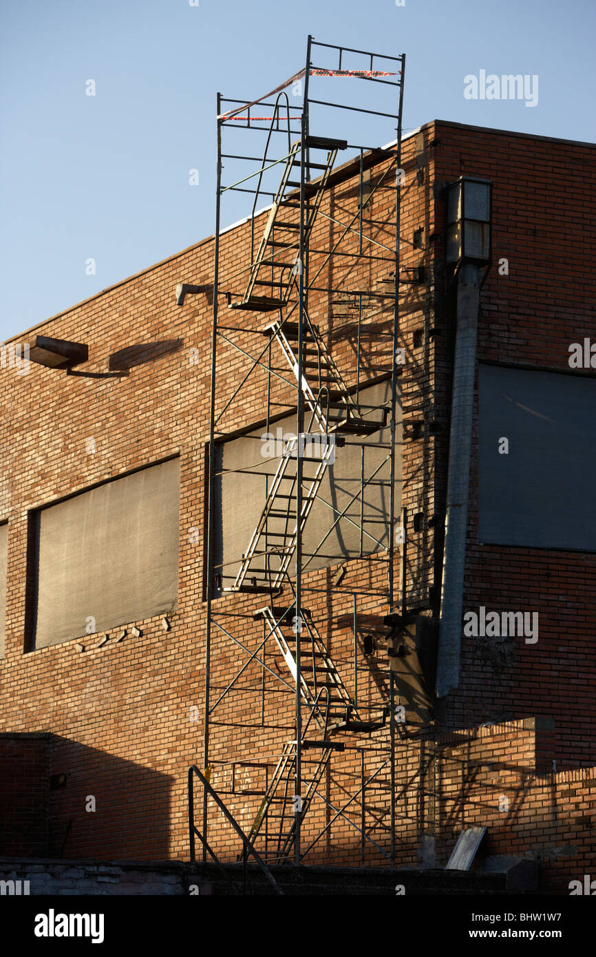 unsafe metal fire escape staircase on the side of a building in south america - Stock Image